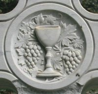 Cup, vine and grapes